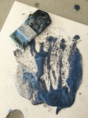 Mod Podge + sand + blue that didn't totally wash out of brush.